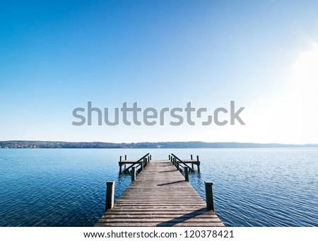 beautiful old wooden jetty - nice background with copy space - stock photo