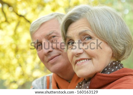 Beautiful older couple walking in the fresh air - stock photo