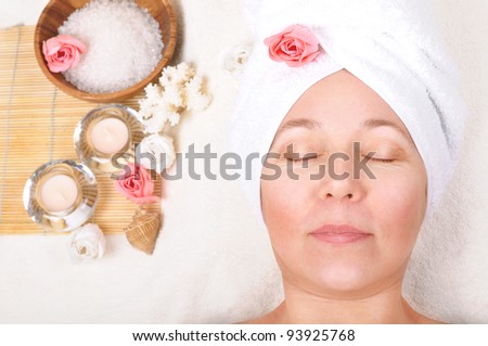 beautiful older woman and a spa concept - stock photo