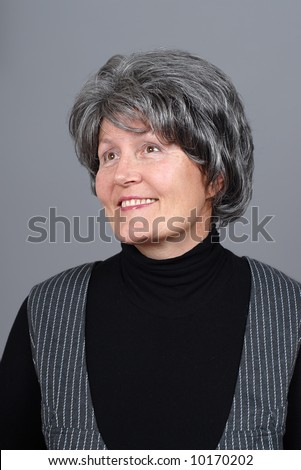 Beautiful older woman thinking about something and smiling - stock photo