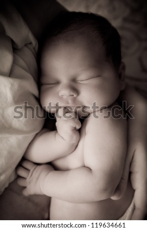 Beautiful one week old baby boy a sleep. Black and White image of resting baby boy