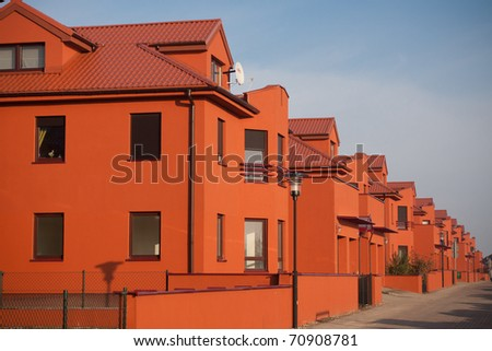beautiful orange apartments with blue sky - stock photo