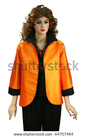 Beautiful orange silk dress on a dummy isolated on white
