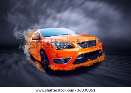 Beautiful orange sport car in fire - stock photo