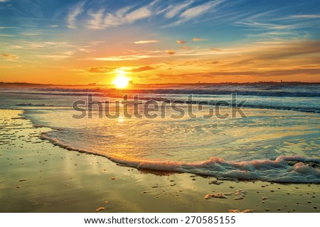 Beautiful orange sunset at the beach  - stock photo