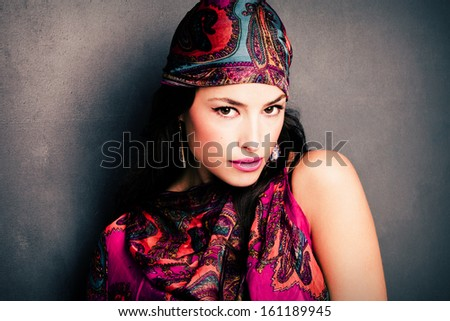 beautiful oriental look young woman portrait with scarf
