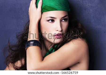 beautiful oriental look young woman portrait with scarf  - stock photo