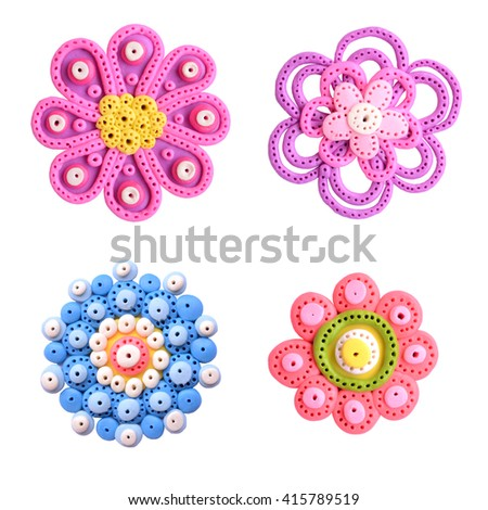 Beautiful, ornamental flowers. On a white background. Stuff is made from clay. - stock photo