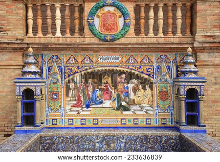 Beautiful ornate ceramic tiles, depicting the history of Spain in the historical Plaza de Espana or Spanish Square. Seville, Spain. - stock photo