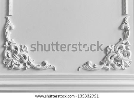 Beautiful ornate white decorative plaster moldings in studio - stock photo