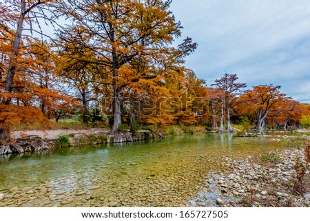 Beautiful Outdoor Fall Foliage Surrounding the Crystal Clear Emerald Green Frio River at Garner State Park, Texas.