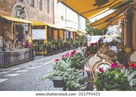 Beautiful outdoor restaurant in Vilnius on beautiful summer day - stock photo