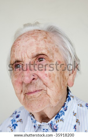 beautiful over 90 years old german woman smiling - stock photo
