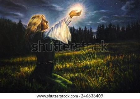 beautiful painting oil on canvas of a mystical young woman in green emerald medieval dress is holding a glowing ball of light in her palms amids a nocturnal meadow  profile portrait   - stock photo