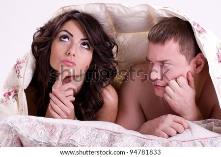 Beautiful pair of lovers in bed - stock photo