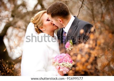 Beautiful pair of newlyweds - stock photo