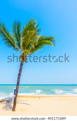 Beautiful palm tree on the tropical beach and sea - Boost up color Processing