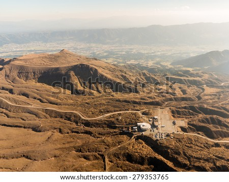 Beautiful Panorama Aerial View Crater of Ropeway Station Mount Aso Volcano Caldera largest active Volcano in Japan Island eruption under Summer Sunny Clear Blue Sky Daytime, Kumamoto, Kyushu - stock photo
