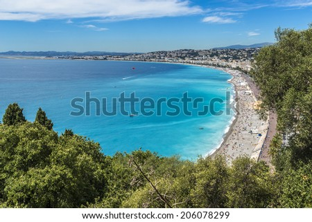 Beautiful panorama city of Nice - luxury resort of French Riviera. Cote d'Azur France. Mediterranean Sea, public beach, Promenade des Anglais, palms and houses of Nice.