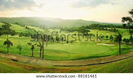 Beautiful panorama golf course in sunrise - stock photo