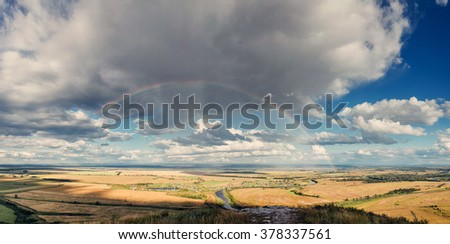 Beautiful panorama landscape with a rainbow in the sky aerial view
