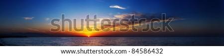 Beautiful panorama of sunset in the sea - stock photo