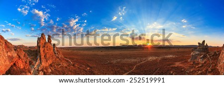 Beautiful panorama of the afternoon sunset at 'La Fenetre', in Isalo national park in Madagascar - stock photo