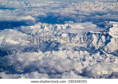 Beautiful panorama of the Alps covered with snow and clouds