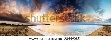 Beautiful panorama of the coastline of Maroantsetra in Madagascar at sunrise, with a dramatic sky and cloudscape - stock photo