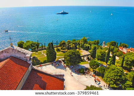 Beautiful panoramic aerial view from the bell tower of the St. Euphemia's Basilica to harbour of old town Rovinj (Rovigno).Scenic natural landscape at summer sunny day. Istria. Croatia.Europe. - stock photo