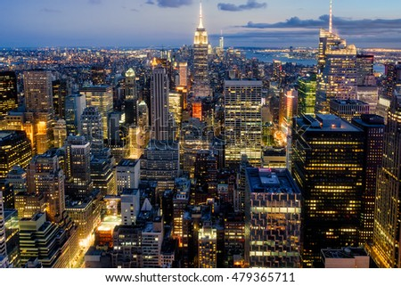 Beautiful panoramic aerial view of New York City at sunset with all the buildings and skyscrapers illuminated