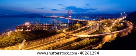 Beautiful panoramic night scenes of Tsing Ma Bridge in Hong Kong. - stock photo