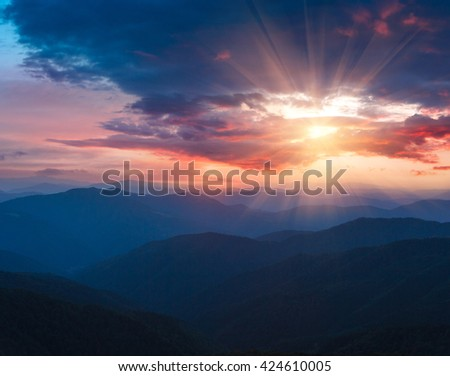 Beautiful  panoramic sunset in the mountains landscape. Dramatic evening sky.