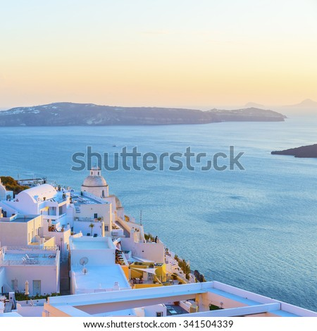 Beautiful panoramic view from famous touristic Fira town to caldera of the Santorini (Thira) island at sunset.Picturesque natural landscape.Cyclades.Greece.Europe. - stock photo