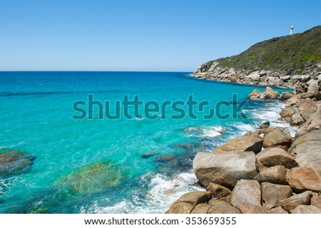Beautiful panoramic view of cliff coast at Torndirrup National Park, Albany, Western Australia, wild Southern Ocean, blue sky, copy space. - stock photo
