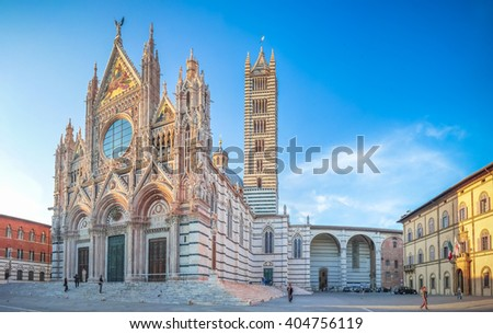 Beautiful panoramic view of famous Piazza del Duomo with historic Siena Cathedral at sunset, Tuscany, Italy - stock photo