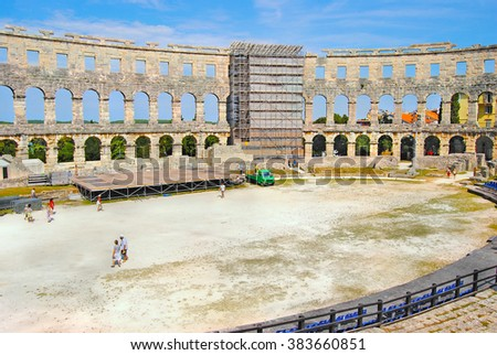 Beautiful panoramic view on the ancient Amphitheater in the Pula town. Famous touristic landmark of Istria at Adriatic Sea. Scenic architectural landscape at summer sunny day. Croatia. Europe. - stock photo