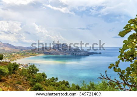 Beautiful panoramic view on the bay and beach at Plakias village after the storm.Picturesque natural landscape.Crete island. District of Rethymno.Greece.Europe.