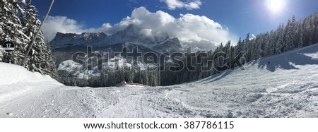Beautiful panoramic view on the ski slopes with Alps mountains on the background - stock photo