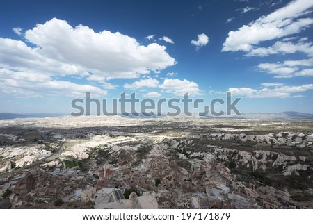 """Beautiful panoramic view to the cave / underground city from the Uchisar town's castle in Turkey, Cappadocia region, most visually striking region having a """"moonscape"""" landscape - stock photo"""