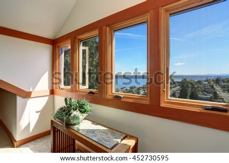 Beautiful panoramic water view from the window. House exterior.