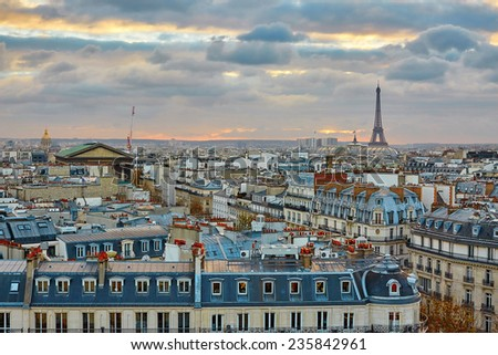 Beautiful Parisian skyline with the Eiffel tower with dramatic colorful sunset - stock photo