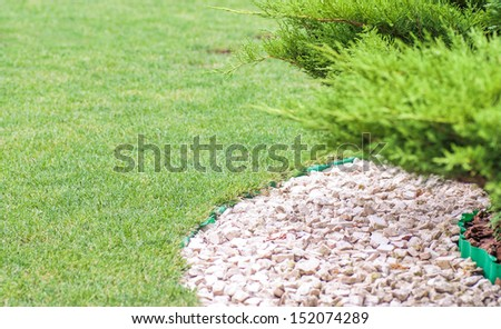 Beautiful park garden in summer and a path of stones - stock photo