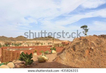 Beautiful Park in Bedouin Village with Ancient Vases and Cactuses in Hurghada in Desert surrounded by Mountains, Tourist Place