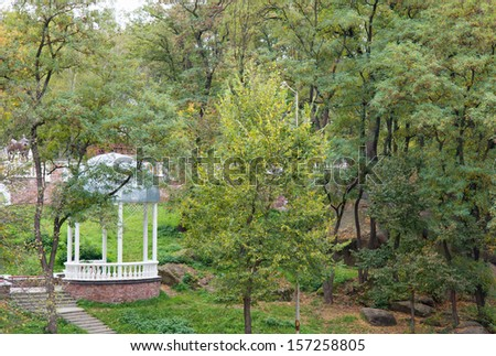 Beautiful park with a small white gazebo