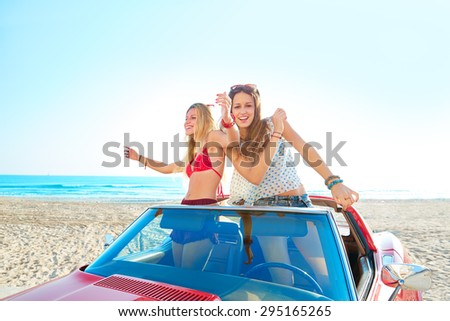 Beautiful party friend girls dancing in a car on the beach happy - stock photo
