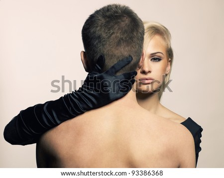 Beautiful passionate girl hugging a man by the neck - stock photo