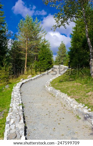 Beautiful pathway edged with stones - stock photo