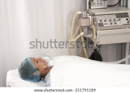 Beautiful patient receives anaesthetic in hospital