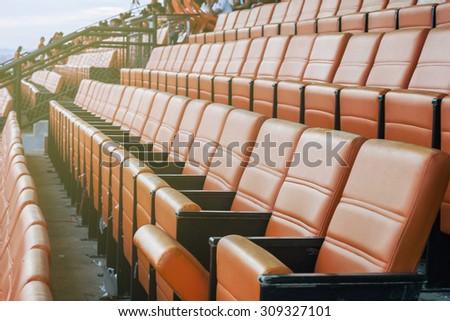 beautiful pattern of the orange seats in the stadium  - stock photo